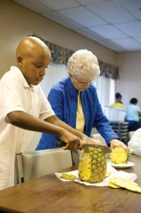 Joshua Grissom and Sister Bobby English prepare a meal together