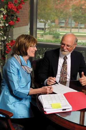 Dr. Richard and director Sharon planning a new oncology urgent care center.