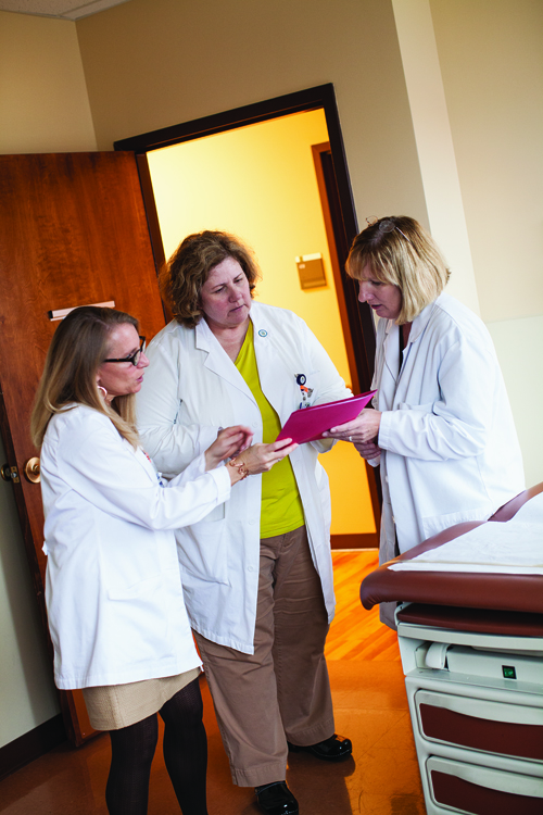 Nurses looking over a file at the Memory Clinic
