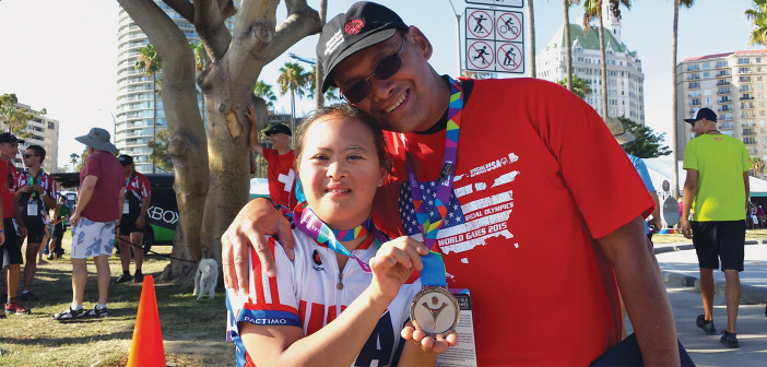 Alex Gogue, a bicyclist in the 2015 Special Olympics, with her dad, Alex Gogue