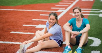 Master's Entry students Zoe Lim, left, and Kelsi Brooks before a workout in Patterson Park.