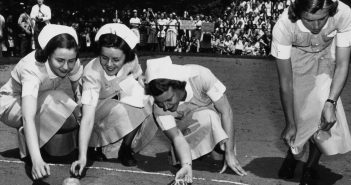 Students of the Johns Hopkins Hospital Training School for Nurses enlist their powers of persuasion and tender touch to urge on participants of a 1950s turtle race, with decidedly mixed results.