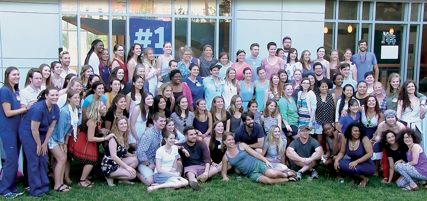 the final baccalaureate cohort of the Johns Hopkins School of Nursing celebrates in the courtyard.