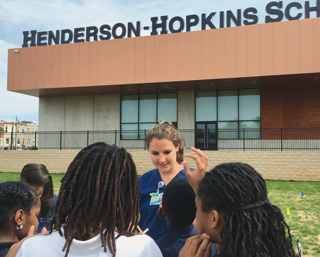 Colleen Keany of the MSN: Entry into Nursing program at a health fair at the Henderson-Hopkins School.